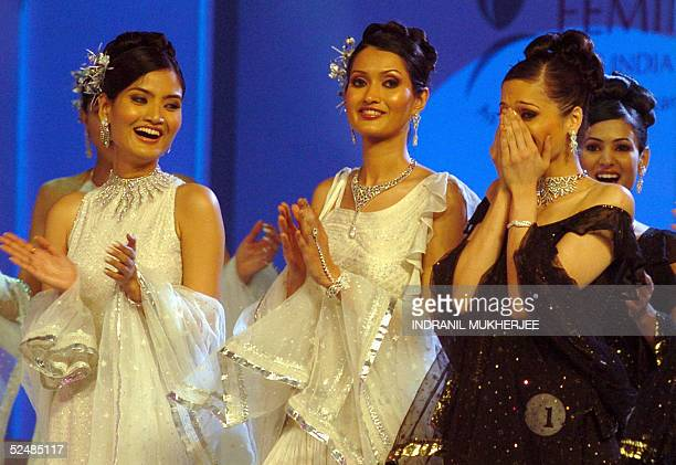 Contestants applaud Winner of the Pond's Femina Miss India 2005 Universe Amrita Thapar as she reacts on hearing her name as the winner during the...