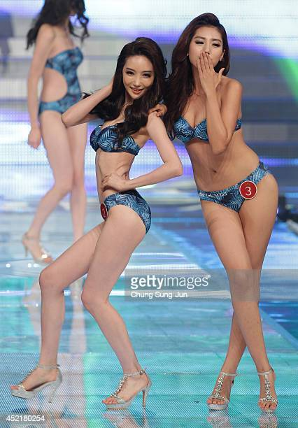 Contestants Baek YeRim and Park SoYun perform onstage during the 2014 Miss Korea Pageant on July 15 2014 in Seoul South Korea Miss Korea will go on...