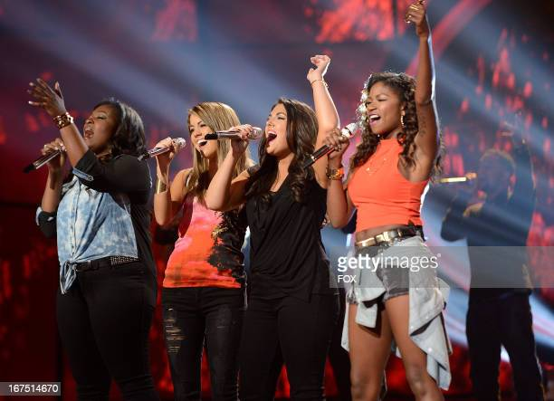 Contestants Candice Glover Angie Miller Kree Harrison and Amber Holcomb perform onstage at FOX's American Idol Season 12 Top 4 to 3 Live Elimination...