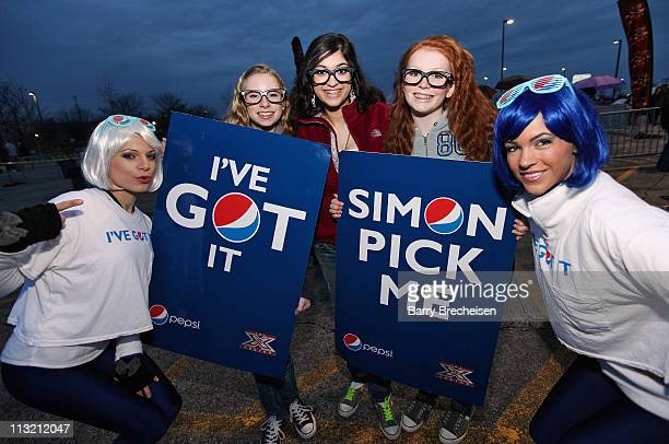 Contestants Catalie Pitts Meghan Bhattacharya and Sabrina Murray pose with the PEPSI PEP Girls during X Factor and official sponsor Pepsi Take on the...