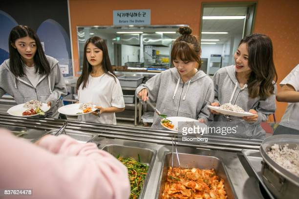 Contestants choose food inside the cafeteria set during the production of the 'Idol School' reality television show by CJ EM Corpat the Yangpyeong...