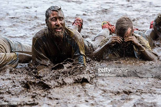 Contestants compete during the 8th mud soccer championship on August 6 2016 in Woellnau near Leipzig Germany Legend has it that a Finnish officer...