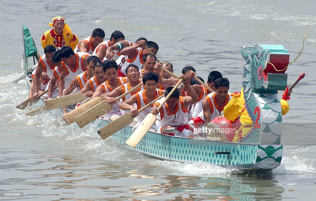 Contestants compete in a Dragon Boat race during the Dragon Boat Festival June 11, 2005 in Chengdu of Sichuan Province, China. The Dragon Boat Festival is celebrated throughout China with activities such as boat races and the eating of sticky rice dumplings known as the 'zongzi.' The festival falls on the fifth day of the fifth month on the Chinese lunar calendar, in remembrance of Qu Yuan, a patriotic poet who committed suicide in the Miluo River on the day in 221 BC.