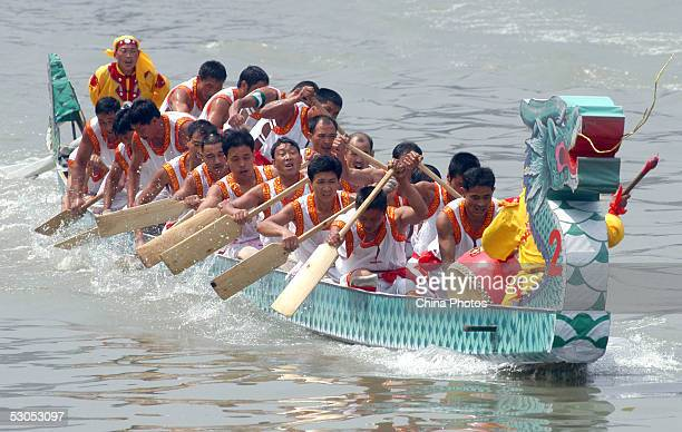 Contestants compete in a Dragon Boat race during the Dragon Boat Festival June 11 2005 in Chengdu of Sichuan Province China The Dragon Boat Festival...
