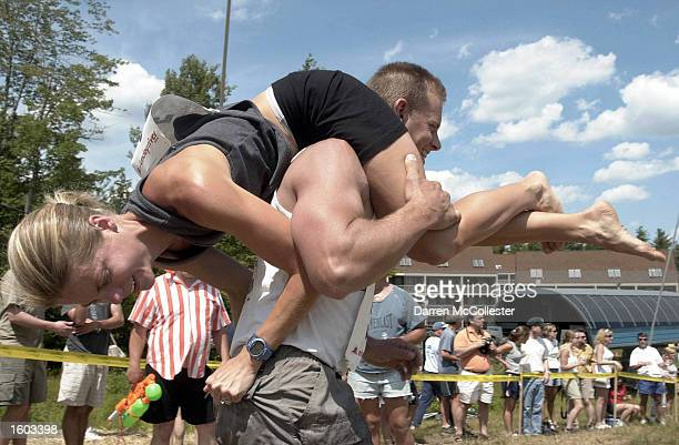 Contestants compete in the 2nd annual North American Wife Carrying Championships July 21 2001 in Newry ME The events a Finnish tradition are inspired...