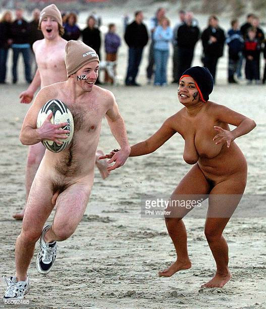 Contestants compete in the annual nude rugby game played on St Kilda beach before the New Zealand v England Rugby Test Match to be played at...