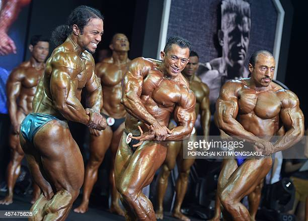 Contestants compete in the first round of the pro class category during the Fitwhey classic 30 grand bodybuilding competition in Bangkok on October...