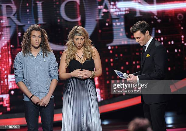 Contestants DeAndre Brackensick and Elise Testone and host Ryan Seacrest onstage at FOX's 'American Idol' Season 11 Top 8 To 7 Live Elimination Show...