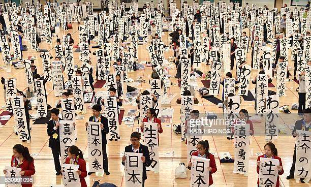 Contestants display their calligraphy banners during the annual New Year calligraphy contest in Tokyo on January 5 2017 About 3000 people took part...