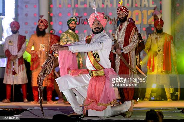 Contestants display traditional Sikh wedding groom attire during the Mr Singh International Turban Pride 2012 Fashion Show in Amritsar late December...