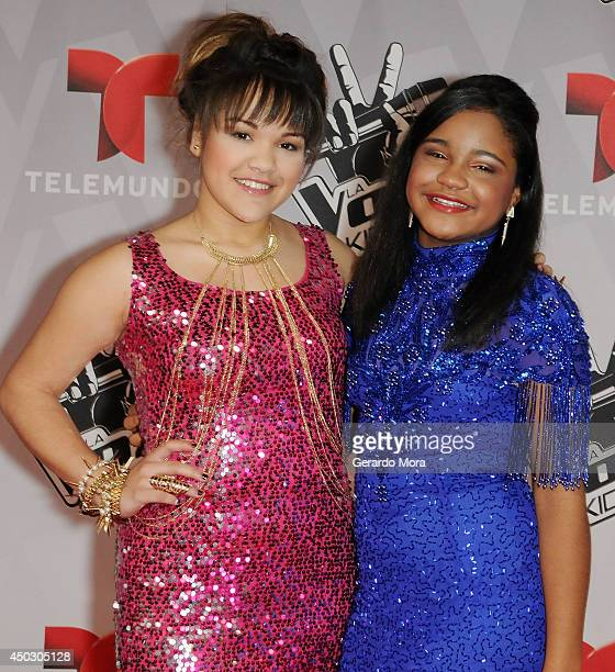 Contestants Dorothy Milary and Amanda Mena pose during La Voz Kids Grand Finale at Universal Orlando on June 7 2014 in Orlando Florida
