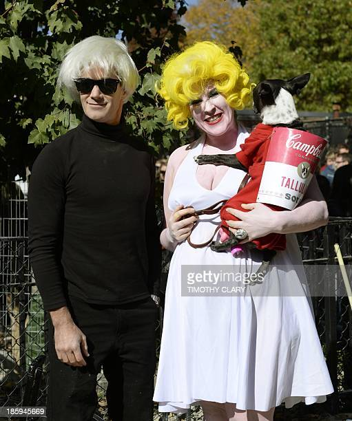 Contestants dressed as Andy Warhol and Marilyn Monroe and Warhol's Campbell Soup painting participate in the 23rd Annual Tompkins Square Halloween...