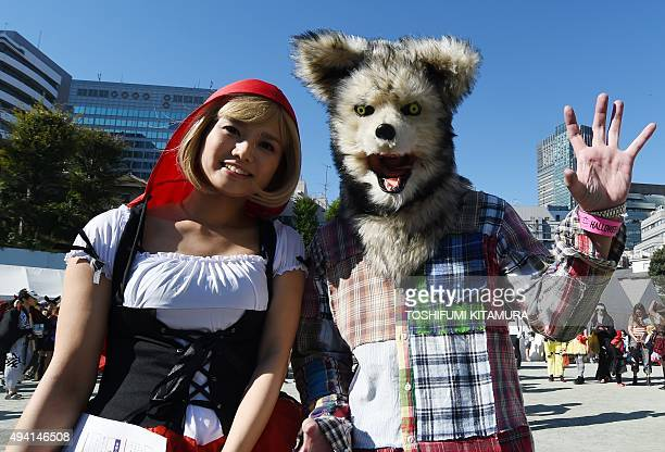Contestants dressed as Little Red Riding Hood prior to the Roppongi Halloween parade in Tokyo on October 25 2015 Some 2000 people took part in the...