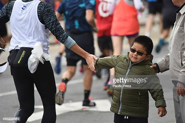 Contestants fill Fourth Avenue in Sunset Park Brooklyn as they pass mile four of the NYC Marathon The 44th annual TCS New York City marathon...