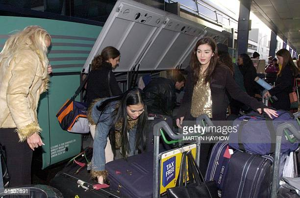 Contestants for Miss World beauty pageant arrive at Gatwick International Airport 24 November 2002 The Miss World pageant slated for Nigeria 07...