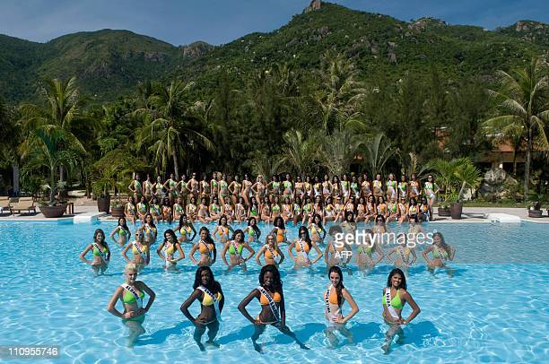 Contestants gather poolside at Diamond Bay Resort and Golf to pose in their BSC Swimwear on July 2 2008 The live competition of the 57th annual Miss...