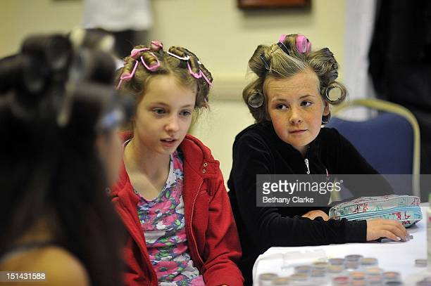 Contestants get ready backstage on July 22, 2012 in Norwich, England. The popularity of US reality show Toddler & Tiaras has boosted the interest in...