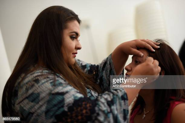 Contestants Haudy Avila and Melissa Cifuentes get ready for a rehearsal for the first Miss Plus Size Guatemala beauty contest in Guatemala City on...