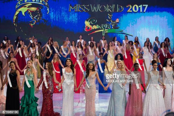 Contestants hold hands and sing at the end of the 67th Miss World contest final in Sanya on the tropical Chinese island of Hainan on November 18 2017...