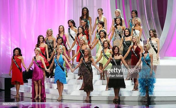 Contestants hold hands as they compete in the Miss America Pageant at the Aladdin Theatre for the Performing Arts January 21, 2006 in Las Vegas,...