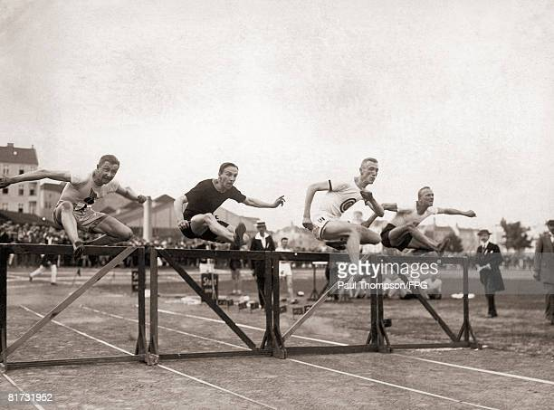 Contestants in the 110 metre hurdles during the German international field meet held by the Berlin Sports Club circa 1930