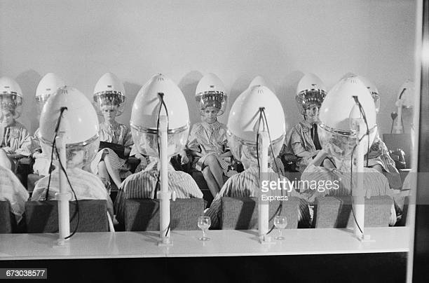 Contestants in the 1960 Miss World contest have their hair done at a beauty salon before the show London UK 7th November 1960