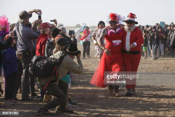 Contestants in the Bashville Drags Fashion Show head for the finish line after a short run through the desert The event raises funds for the Royal...