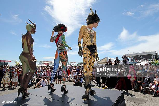 Contestants in the Body Art competition pose during New Zealand Trotting Cup Day at Addington Raceway on November 8 2016 in Christchurch New Zealand