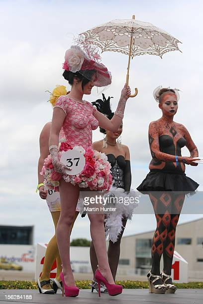 Contestants in the Body Art Fashion pose during the NZ Trotting Cup Day at Addington Raceway on November 13 2012 in Christchurch New Zealand