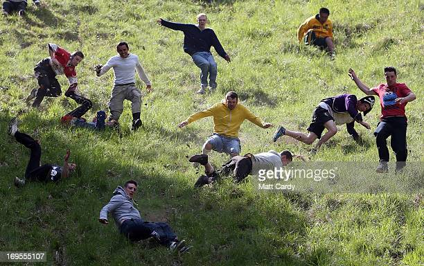 Contestants in the men's race chase a cheese down the steep gradient of Cooper's Hill during the annual Bank Holiday tradition of cheeserolling on...