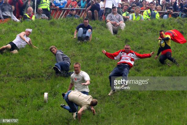 Contestants in the men's race chase a Double Gloucester Cheese down the steep gradient of Cooper's Hill during the annual Bank Holiday tradition of...