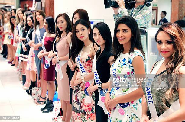 Contestants in the Miss International Beauty Pageant 2016 welcome shoppers at the Mitsukoshi department store on October 12 2016 in Tokyo Japan...