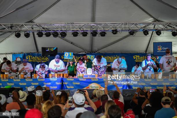 Contestants including Juliet Lee of Germantown MD center left compete on stage in the 2017 Hot Dog Eating Contest qualifier on Saturday June 24 in...