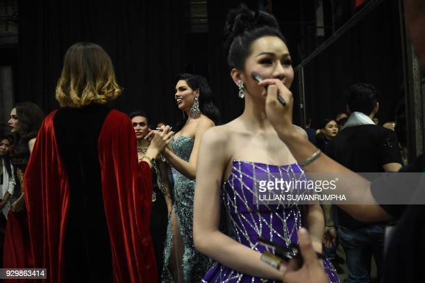 Contestants interact with each other backstage during the Miss International Queen 2018 transgender beauty pageant in Pattaya on March 9 2018 / AFP...