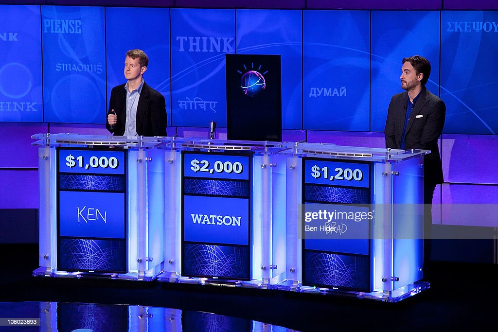 Contestants Ken Jennings and Brad Rutter compete against 'Watson' at a press conference to discuss the upcoming Man V. Machine 'Jeopardy!' competition at the IBM T.J. Watson Research Center on January 13, 2011 in Yorktown Heights, New York.