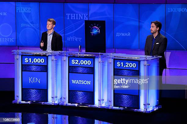 Contestants Ken Jennings and Brad Rutter compete against 'Watson' at a press conference to discuss the upcoming Man V Machine Jeopardy competition at...