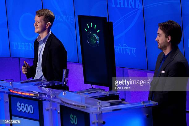 """Contestants Ken Jennings and Brad Rutter compete against 'Watson' at a press conference to discuss the upcoming Man V. Machine """"Jeopardy!""""..."""