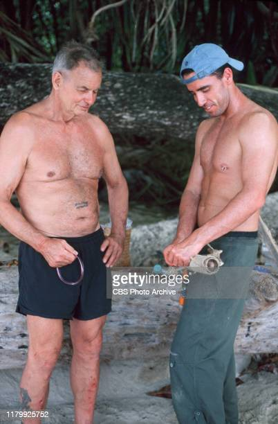 SURVIVOR contestants left to right Rudy Boesch a 72yearold retired Navy SEAL from Virginia Beach and Sean Kenniff from Long Island NY are on Pulau...