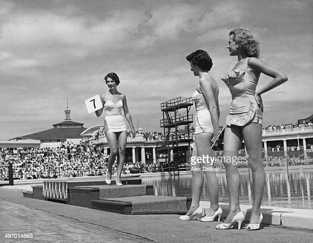 Contestants line up before the judges at a beauty competition at Butlin's holiday camp at Blackpool in Lancashire August 1955 Original publication...