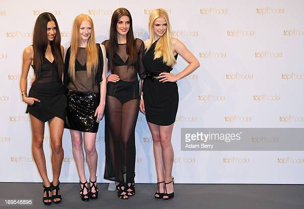 Contestants Lovelyn Enebechi Maike van Grieken Luise Will and Sabrina Elsner pose at a photo call for the reality television show and modeling...