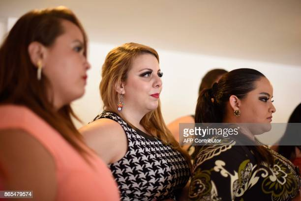 Contestants Melissa Cifuentes Steffannie Espana and Jimena Gaetani listen during a rehearsal for the first Miss Plus Size Guatemala beauty contest in...