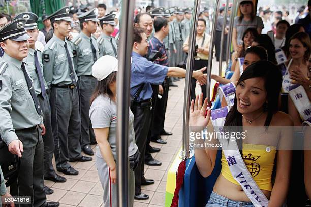 Contestants of 2005 Miss Tourism Queen International wave to Chinese people as they take in the sites of Beijing on June 8 2005 in Beijing China...