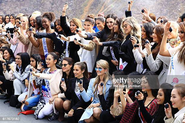 Contestants of Miss International Beauty Pageant 2016 pose for photographs with 'Kuro Tamago' cooked in Owakudani's hot spring on October 24 2016 in...