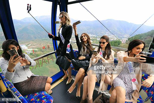 Contestants of Miss International Beauty Pageant 2016 take selfie photographs on the Hakone Ropeway during their visit on October 24 2016 in Hakone...