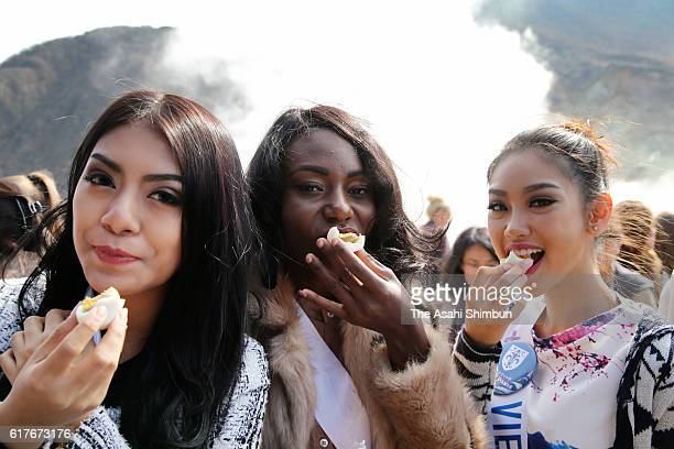 Contestants of Miss International Beauty Pageant 2016 taste 'Kuro Tamago' cooked in Owakudani's hot spring on October 24 2016 in Hakone Kanagawa...