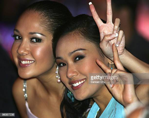 Contestants of the 55th Miss World 2005 Carlene Aguilar of Philippines and Sindie Jensen of Thailand attend a dinner party after the Beachwear Final...