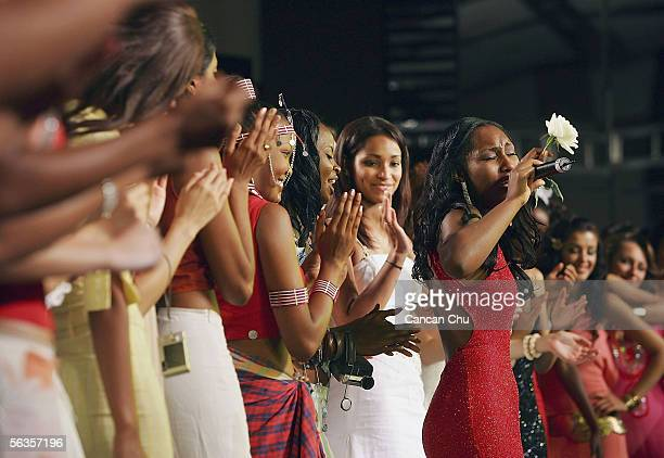 Contestants of the 55th Miss World 2005 cheer as KmishaVictoria Counts of American Virgin Islands sings a song during the Beachwear Final party at...