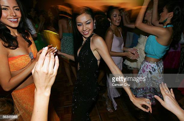 Contestants of the 55th Miss World 2005 dance during a party after the Beachwear Final at the Sheraton Sanya Resort on December 6 2005 in Sanya...
