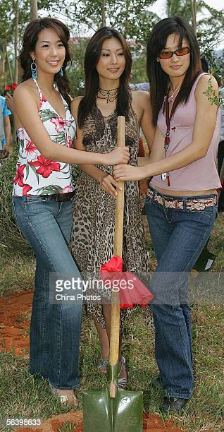 Contestants of the 55th Miss World 2005 Eun Young Oh of South Korea Erina Shinohara of Japan and Ting Ting Zhao of China pose for pictures during a...