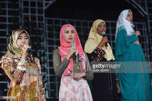 Contestants of the Muslimah World pageant Dayangku Rabiatul Adawiyah of Brunei Futri Virginia of Indonesia Aisha Aderonkie Adeshina of Nigeria and...